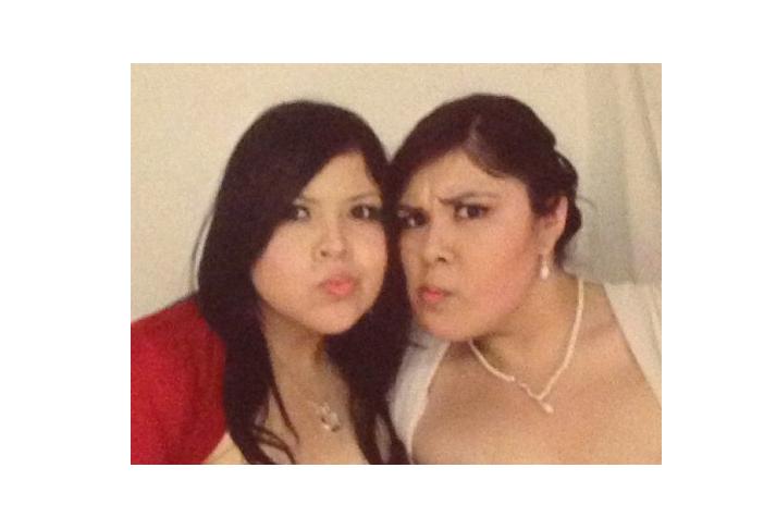 Twin sisters posing